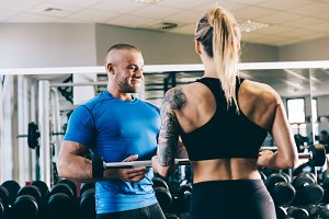 Personal trainer helping a woman wit