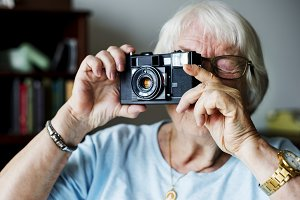 Senior woman taking a picture