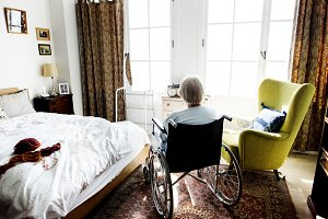 Senior woman sitting on wheelchair