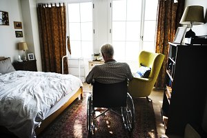 Senior man sitting on the wheelchair