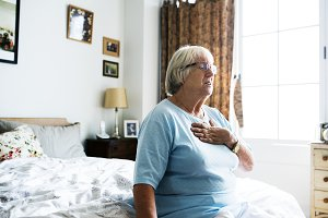 Senior woman having a heart problem