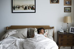 Senior woman sleeping alone