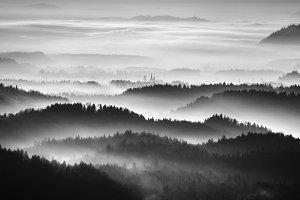 Dramatic and foggy sunrise