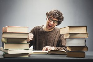 Excited man reading a book, studying