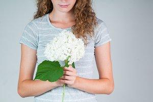 woman holding hydrangeas