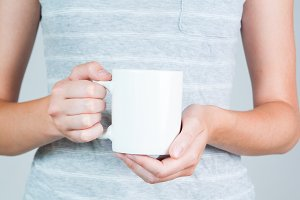 closeup of a woman holding a mug