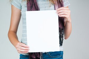 woman holding a piece of paper