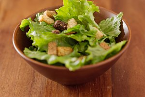 green leafy salad in wooden bowl