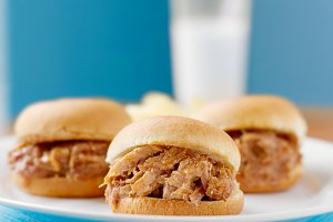 three pulled pork sliders
