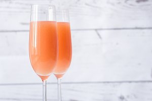 Two glasses of bellini cocktail