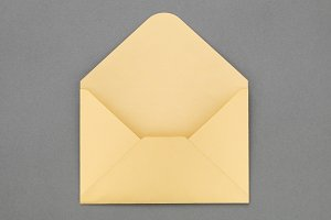 Yellow envelope on gray background.