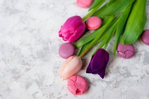 Pink and purple tulips and macarons