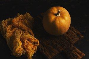 Pumpkin on old cutting Board