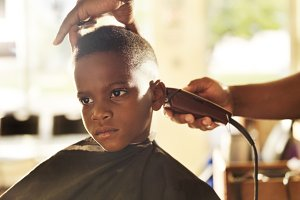little boy getting head shaved