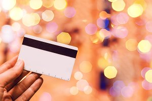 card for payment. bokeh. hand holds