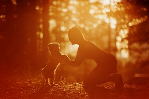 Silhouette of woman and dog