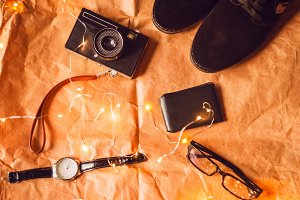 camera, shoes, watch, travel card