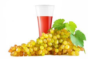 Grape juice in glass and grapes