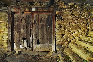 old wooden door of stone house
