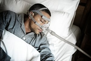 Sick man wearing an oxygen mask