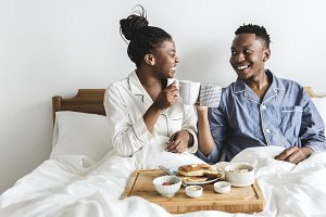 A couple having breakfast in bed