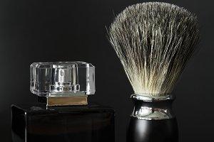 Closeup of shaving brush and perfume