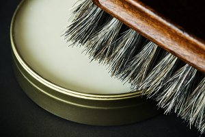 Closeup of shoe brush and polish