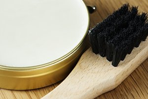 Closeup of shoe brush and polish