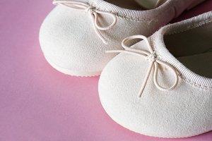 Closeup of baby's pink footwear