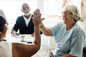 Senior women giving high five