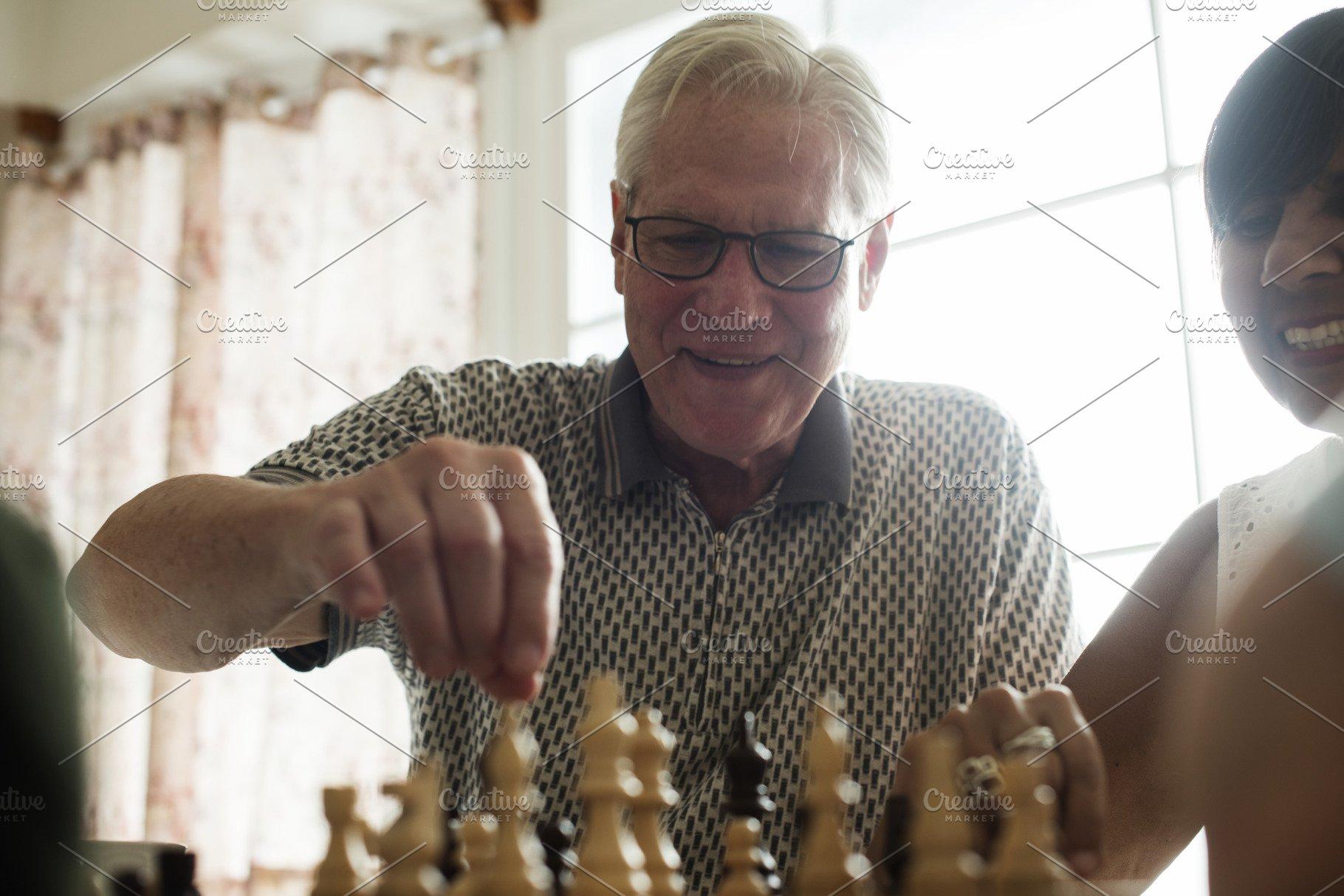 Senior friends playing chess