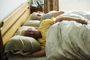 Elderly caucasian couple sleeping