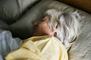 Elderly caucasian woman sleeping