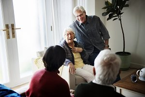 Senior people talking in living room