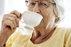 Senior woman sipping tea