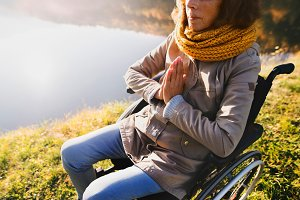 Senior woman in a wheelchair in autumn nature.