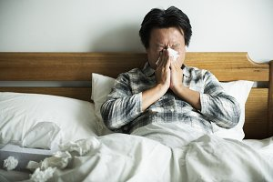 A man sneezing from flu