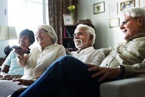 Senior people watching television