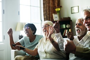 Senior people watching television