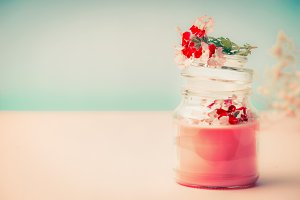 Pink cream in glass jar