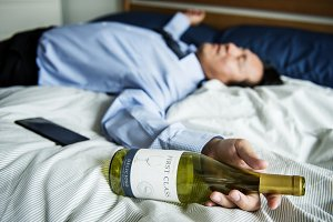 A drunk businessman on bed