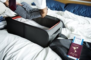 A man preparing his suitcase