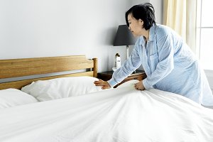A woman making bed