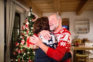 Senior couple exchanging presents at Christmas time.
