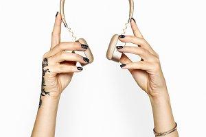 Hand holding headphones (PSD)