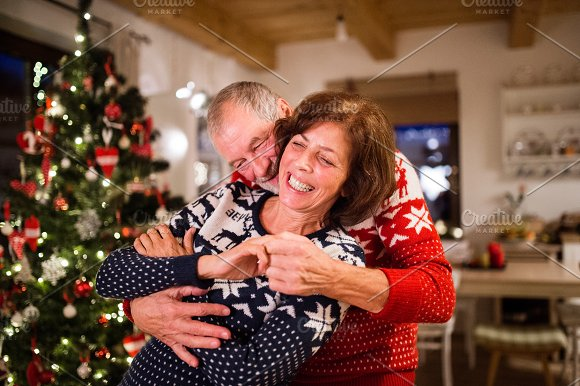 Senior Couple Having Fun At Christmas Time
