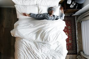 Man on bed sleeping