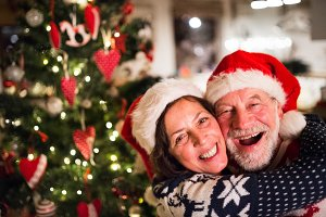 Senior couple with Santa hats at Christmas time.