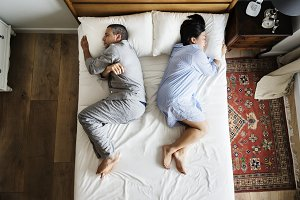Couple sleeping together on the bed
