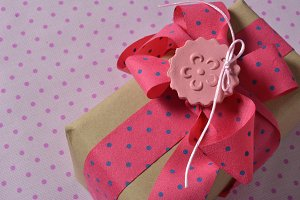 pink and blue polka dot gift box wit